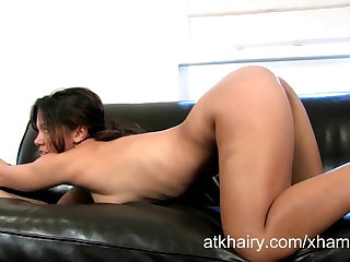 Exotic Lucie plays just about her hairy pussy