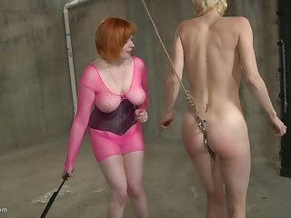 Mature skinny blonde slave girl abused by her redhead mistress