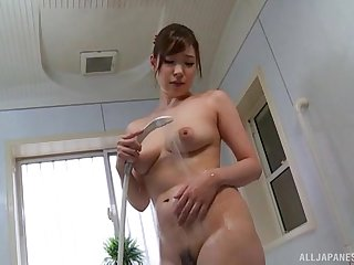 Japanese brunette beauty Shimano Haruka masturbates in a bathroom