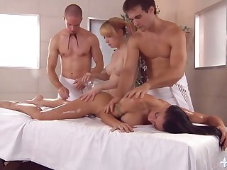 Two masseurs be crazy killing hot busty chicks on the massage table and cum on their cup