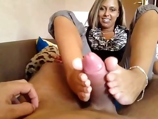 Gorgeous German blonde gives a superb footjob and gets cum on say no to sensational feet